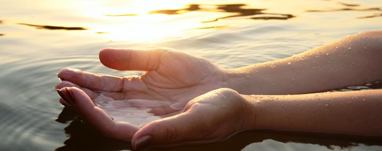 hands in ocean ohana